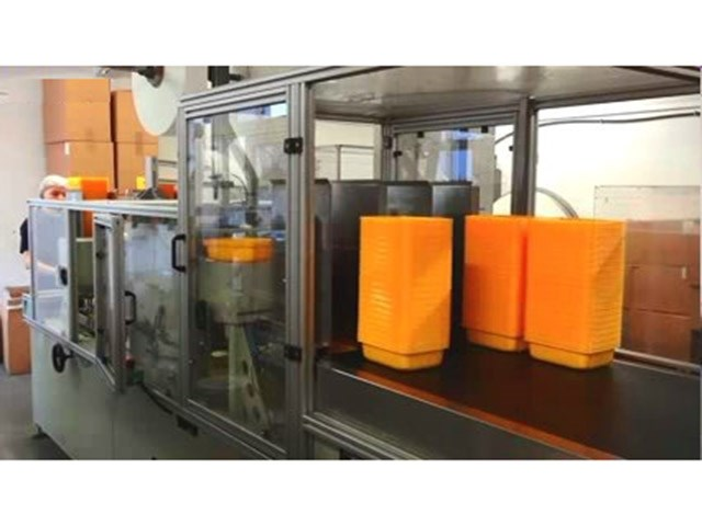 off-line padder for tray